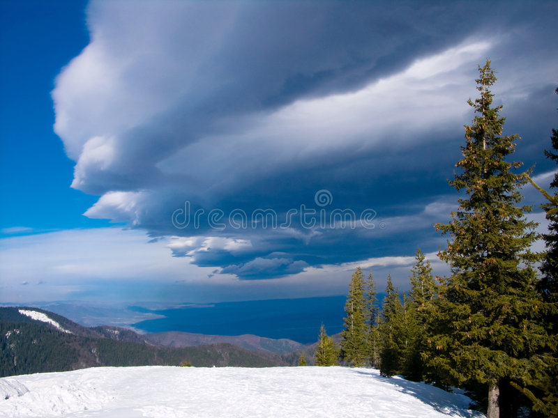 Dark cloud over the Carpathian royalty free stock photography