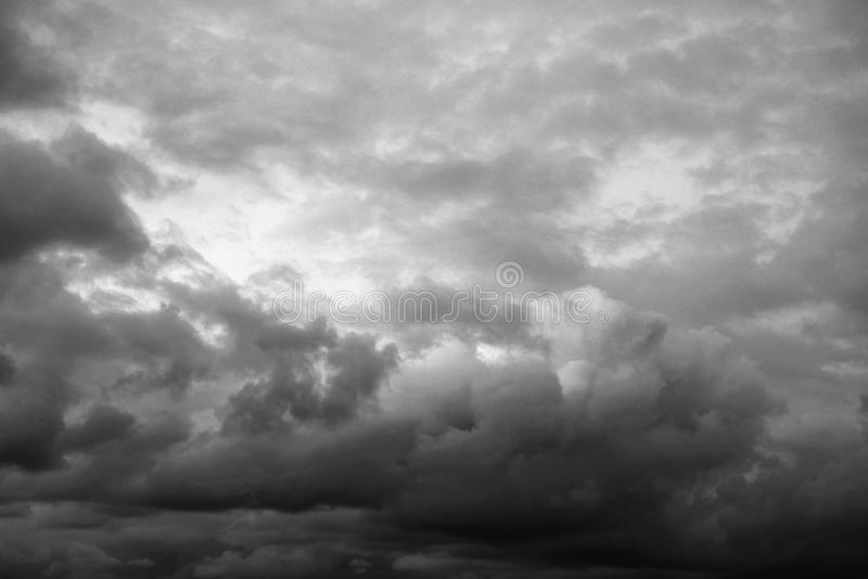Dark cloud sky. May be used as background. Black and white stock photo