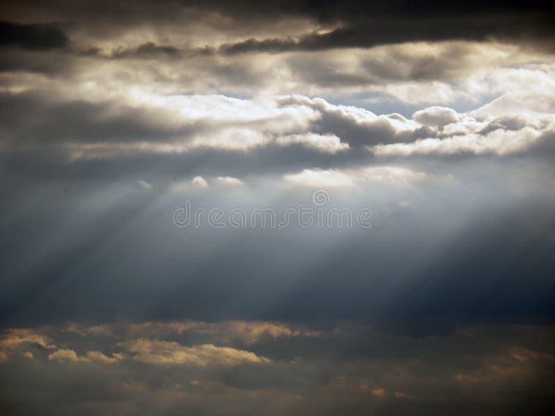 Cloud and sky with sun shining through. Dark Cloud and sky with sun shining through stock images