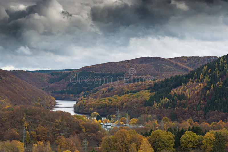 Dark clouds above the National Park in The Eifel, Germany. Dramatic sky above the Rursee during fall in National Park Eifel, Germany stock photography