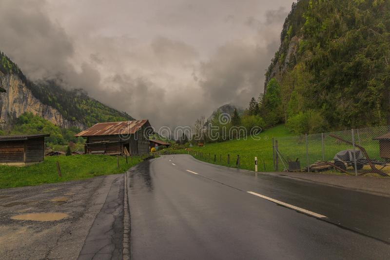 Dark Clouds are approaching. Dark rainy clouds approaching fast during a drive near Lauterbrunnen, Switzerland royalty free stock photography