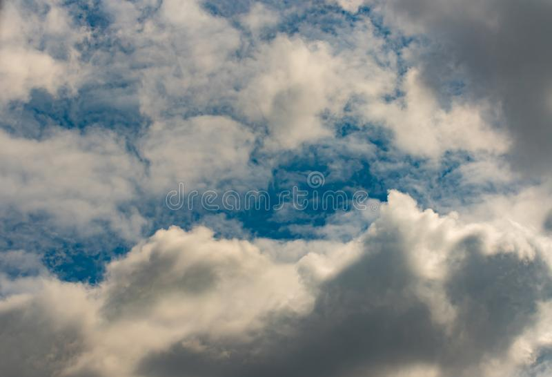 Dark Clouds Background. Beautiful Clouds and Sky Background. Puffy Clouds stock image