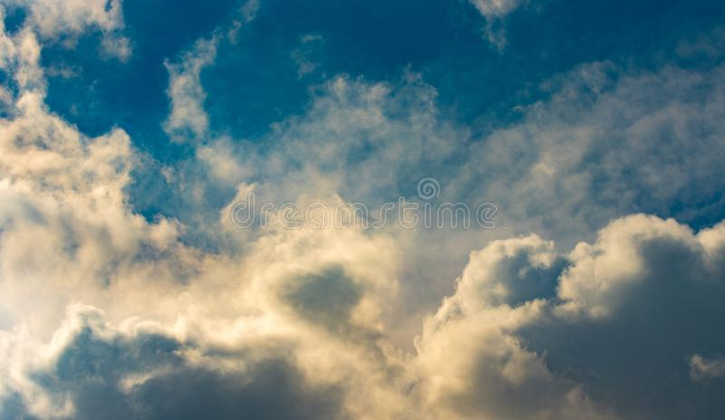 Dark Clouds Background. Beautiful Clouds and Sky Background. Sun rise summer clouds royalty free stock image