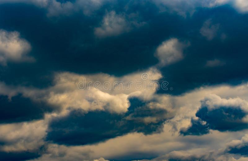 Dark Clouds Background. Dramatic clouds and sky background. Rainy Sky royalty free stock photo