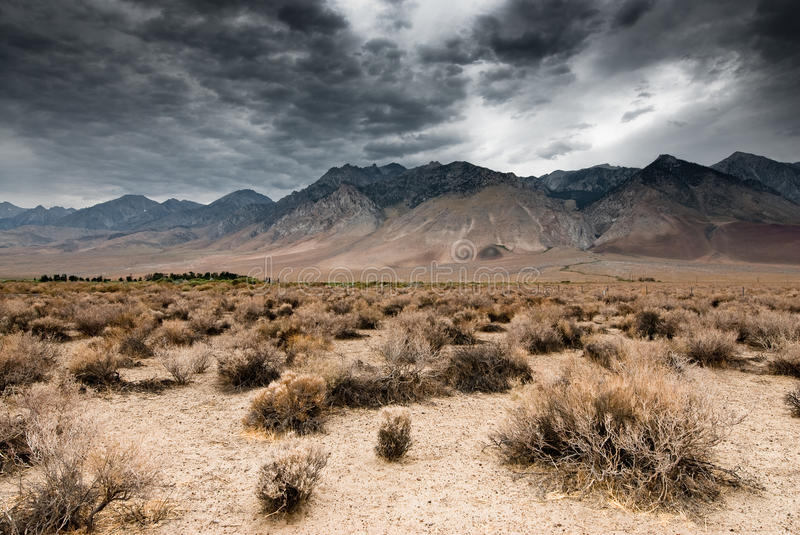 Dark clouds in death valley stock photography