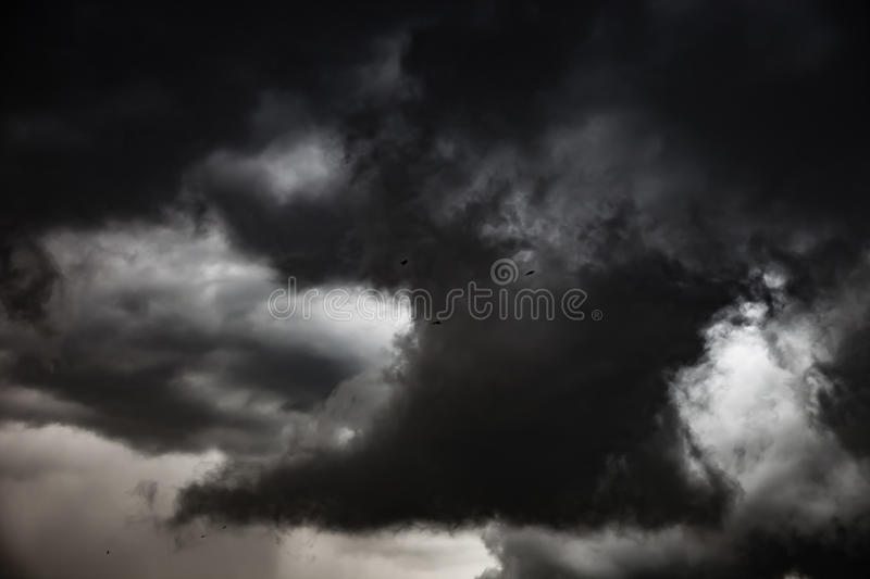 Dark clouds - dramatic sky. Background of dark clouds before a storm stock image