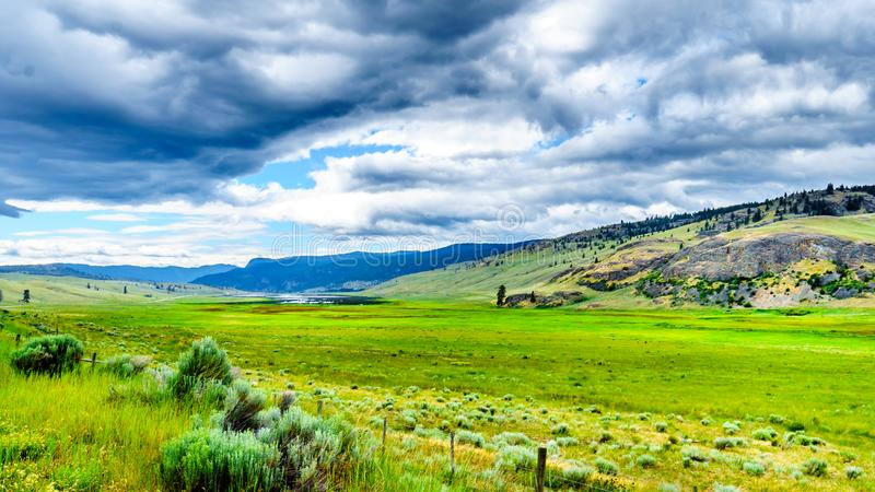 Dark Clouds hanging over the fertile farmland and rolling hills along Highway 5A near Nicola Lake, between Kamloops and Merritt stock photos