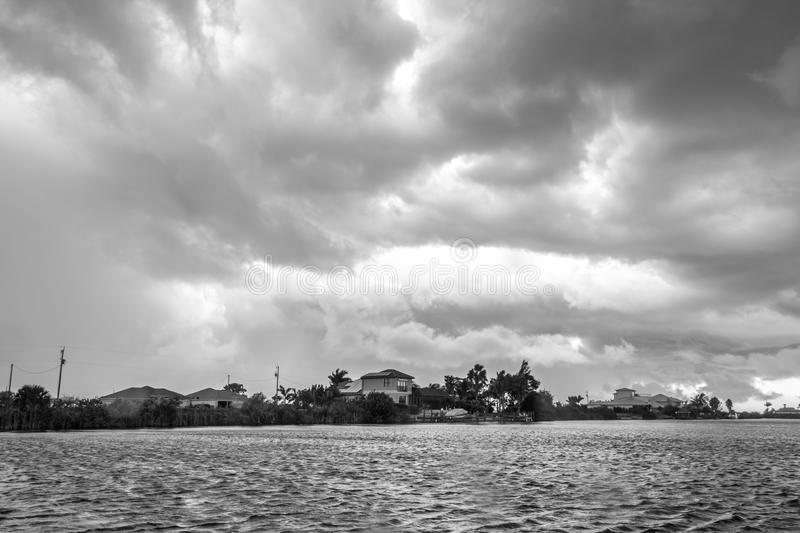 Dark clouds hovering over the water. Before a heavy storm in Cape Coral, Florida royalty free stock photography