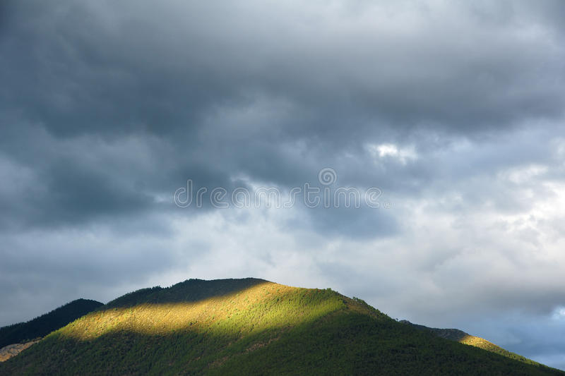 Dark clouds and mountain stock photography