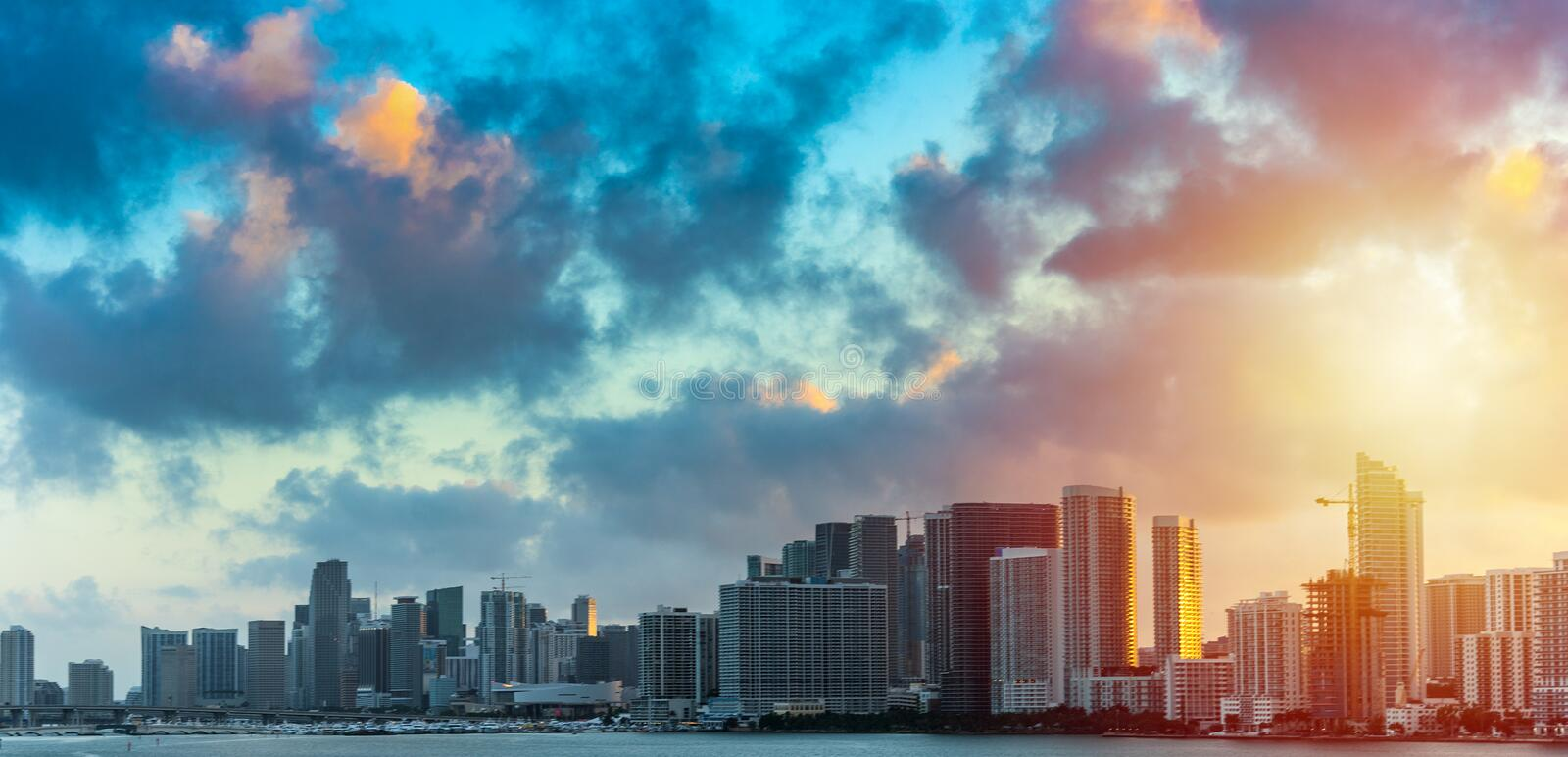 Dark clouds over downtown Miami at sunset. Southern Florida, USA royalty free stock images