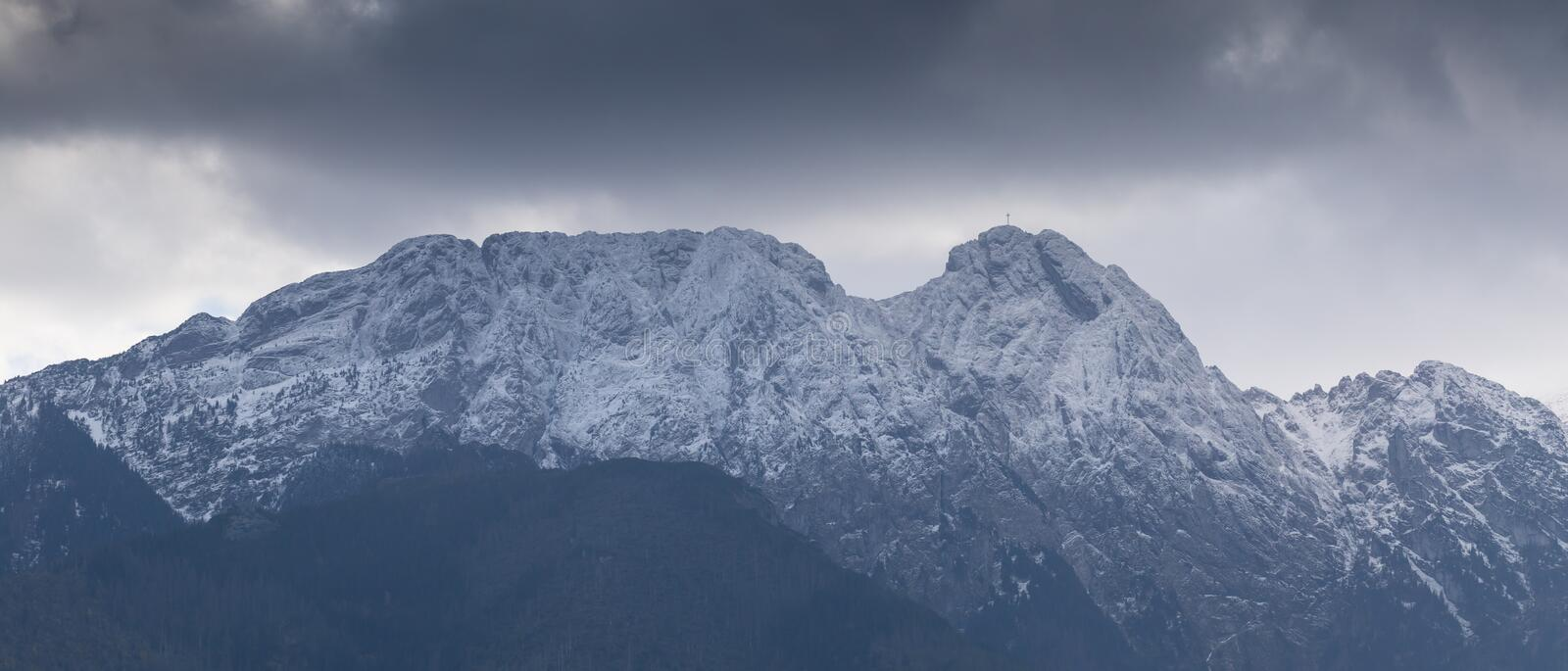 Dark clouds over the Giewont Mountain in polish Tatra Mountains near Zakopane in Poland.  stock photos
