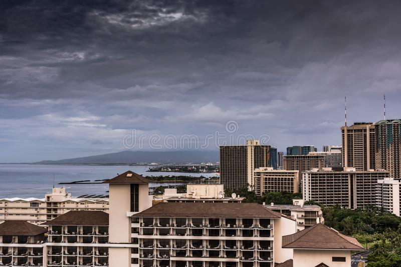 Dark Clouds Over Honolulu in Hawaii. Honolulu, Hawaii / USA - August 26, 2018: Aerial view of clouds over Waikiki tall buildings as aftermath of Hurricane Lane royalty free stock photo