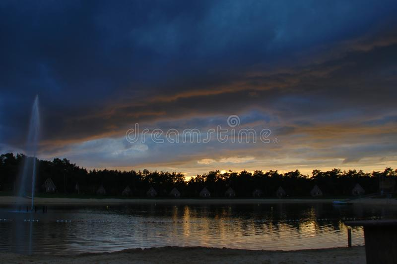 Dark clouds over the lake of Landgoed `t Loo awaiting of a thunderstorm and rain. royalty free stock photos