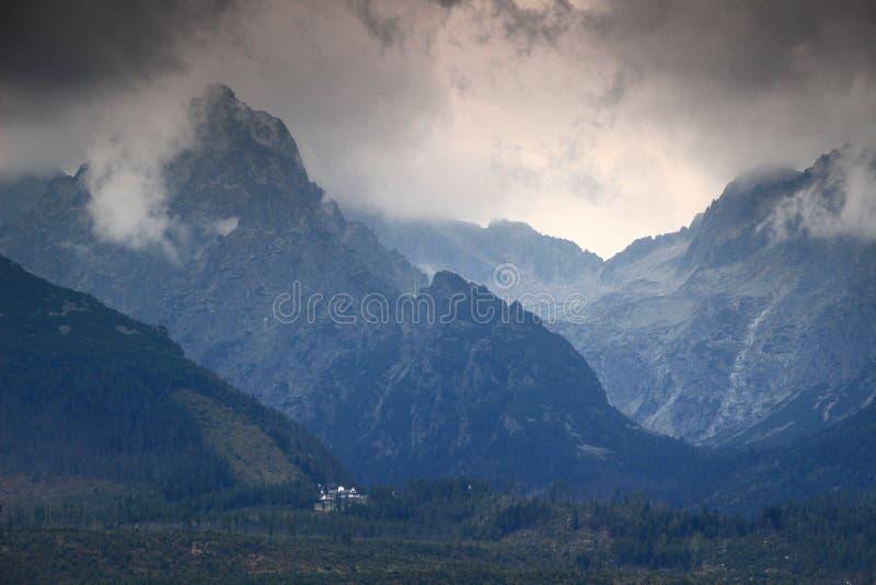 Dark clouds over Prostredny Hreben Ridge and Studena valleys, High Tatras. Threatening clouds over Prostredny Hreben Ridge and the entrances to Velka Studena and stock photos