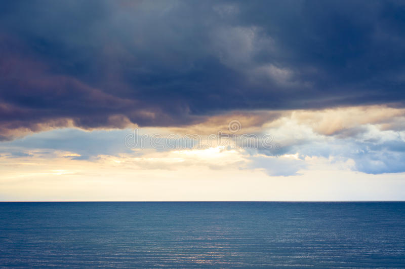 Dark clouds over the sea stock photography