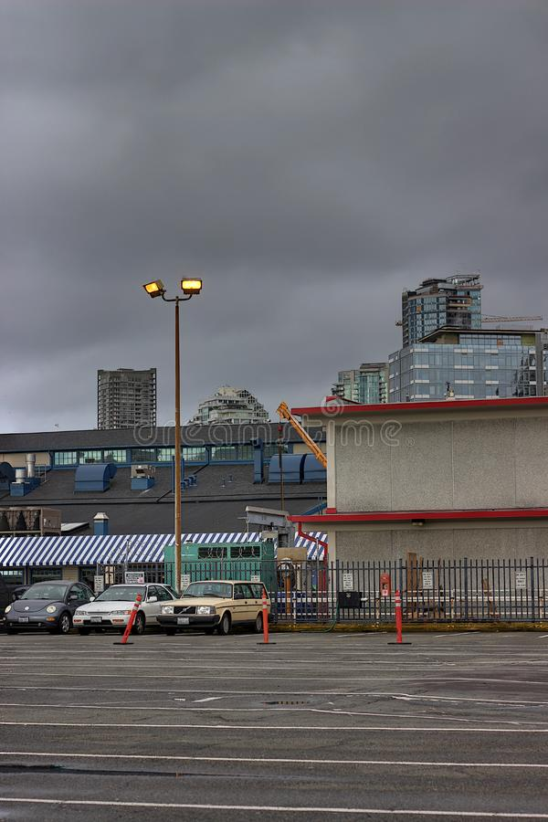 Dark Clouds over Seattle Parking Lot royalty free stock image