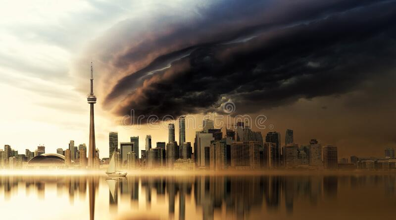 Dark clouds over the skyscrapers in Toronto, Canada. The dark clouds over the skyscrapers in Toronto, Canada royalty free stock image