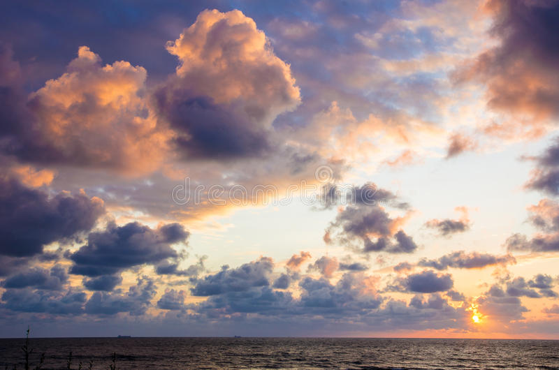 Dark clouds at sunset royalty free stock photography