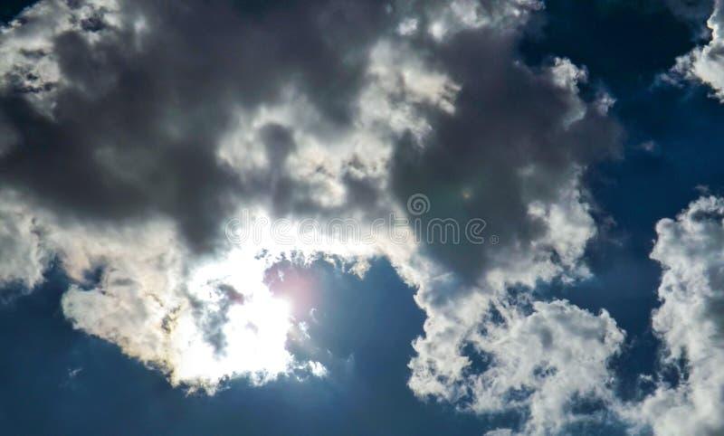Dark cloudscape nature photograohy. Beautiful dark clouds in dark blue sky. stock photos