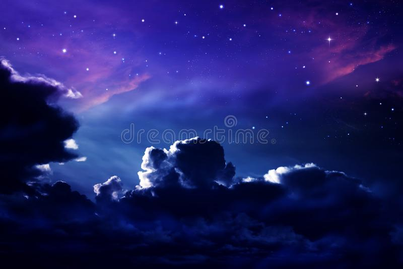 Dark cloudy night sky with stars and nebulae stock images