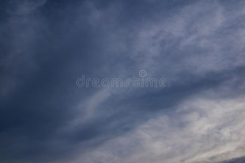 Dark cloudy sky with fleece clouds. royalty free stock image