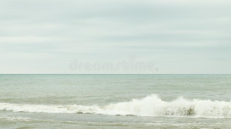 Dark cloudy sky over sea stock photography