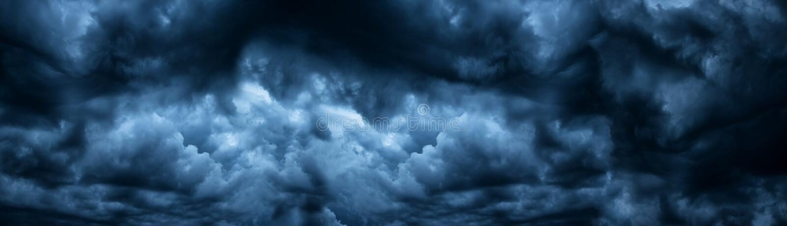 Dark cloudy sky before thunderstorm panoramic background. Storm heaven panorama. Large gloomy backdrop. Dark cloudy sky before thunderstorm panoramic background royalty free stock photo