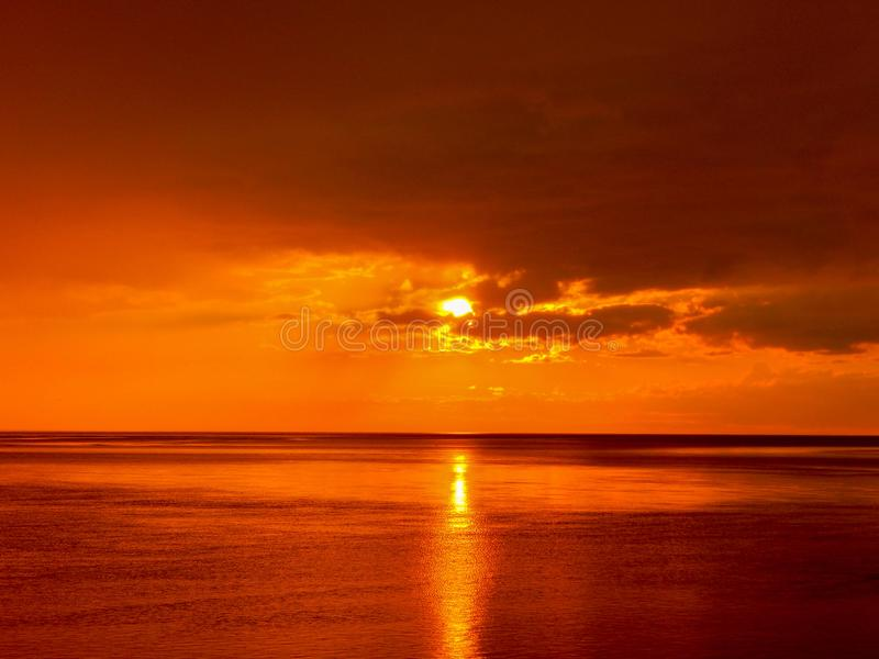 Dark cloudy sunset over the White Sea coast in Russia stock image