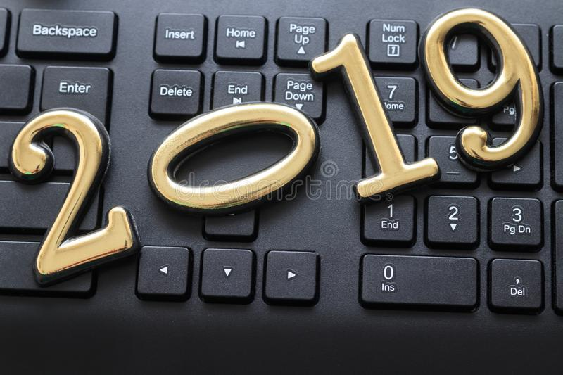 Dark color keyboard. on it are the numbers 2019 gold. have toning. Christmas background business computer abstract icon internet office technology button stock images