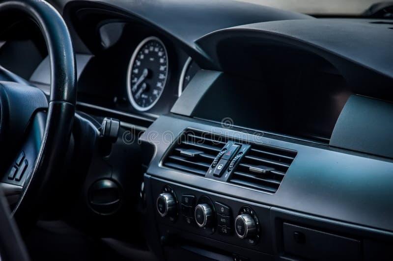 Modern car interior. Dark colored Interior of modern car royalty free stock photography