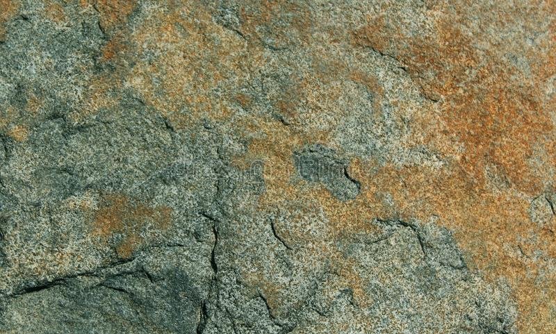Dark colored natural hill stone texture background. Rural of india, asia royalty free stock image