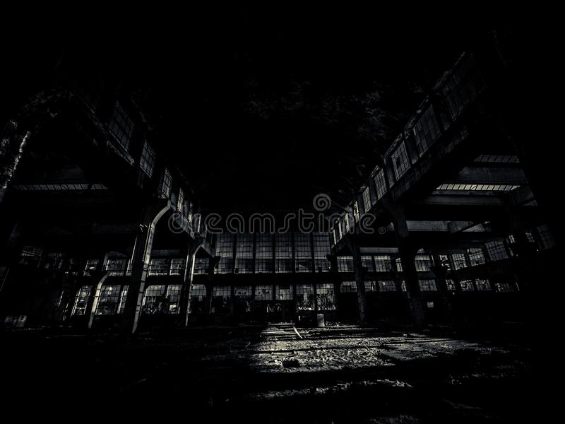 Derelict factory in black and white. A dark contrast, black and white shot of an old forgotten factory in the Czech Republic royalty free stock image