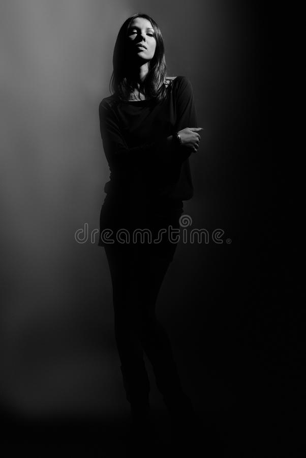 Dark contrast shot of beautiful fashion model. Beautiful fashion model on dark background stock photos