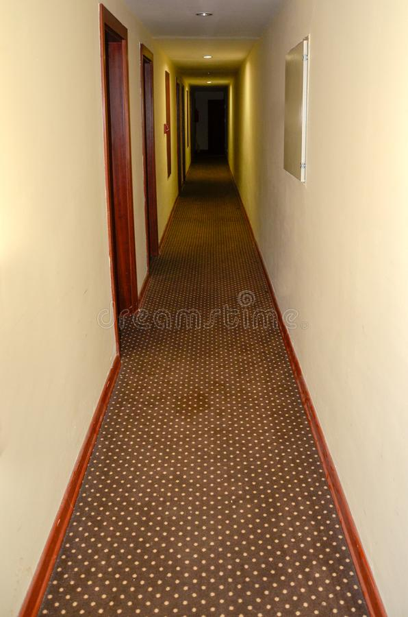 Dark corridor of the hotel with carpet stock images