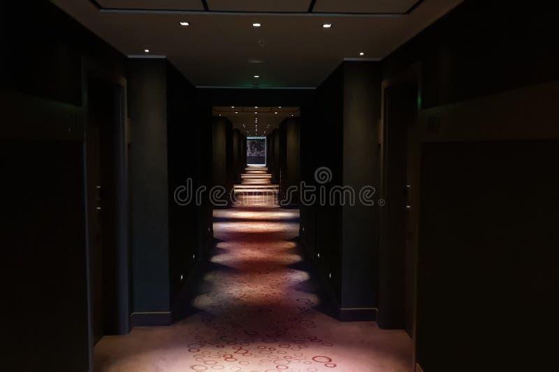 Dark corridor of the hotel. Illuminated at night royalty free stock photo