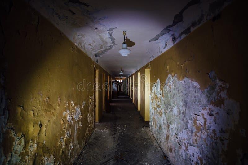 Dark creepy corridor of abandoned building stock photos