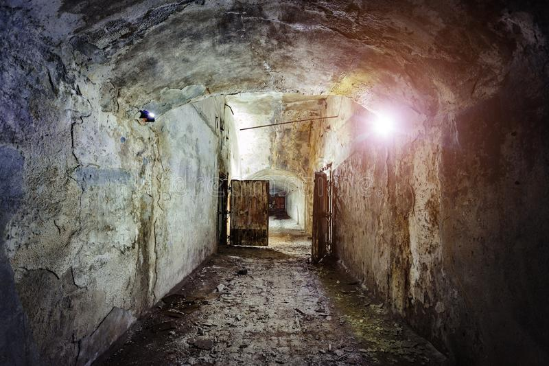 Dark and creepy corridor of old abandoned forgotten Soviet underground bunker.  royalty free stock image