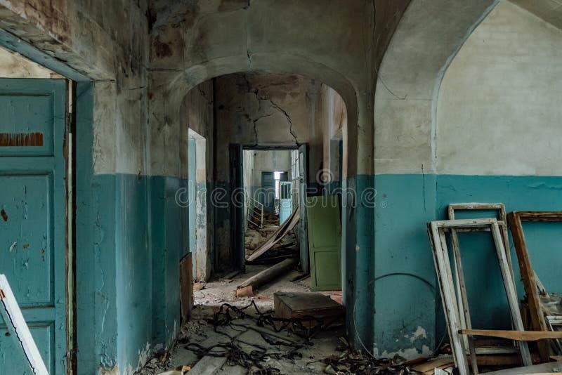 Dark and creepy corridor of old abandoned hospital.  stock photos