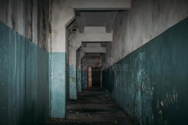 Dark creepy corridor in scary abandoned building, horror atmosphere. Perspective stock photos