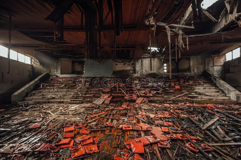 Dark creepy interior ruined collapsed abandoned stage or cinema theater.  stock photography