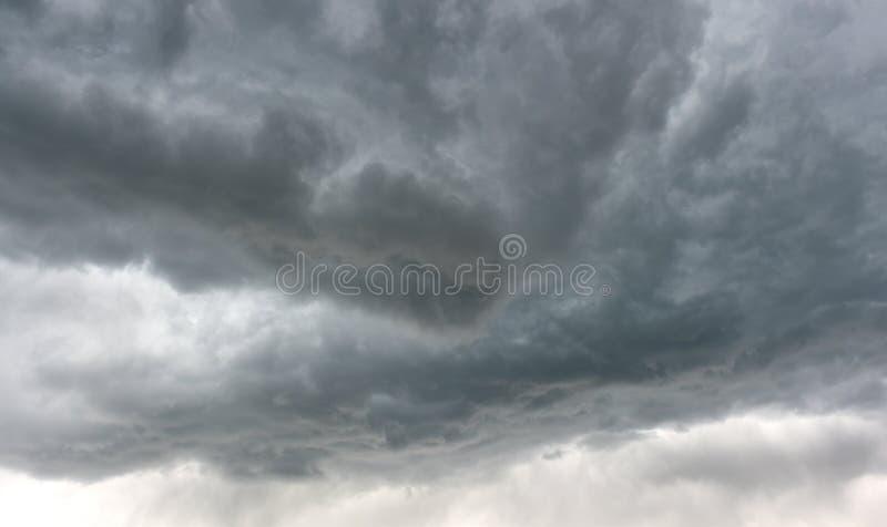 Dark dangerous gray storm clouds of thunderstorm in Idaho sky stock image