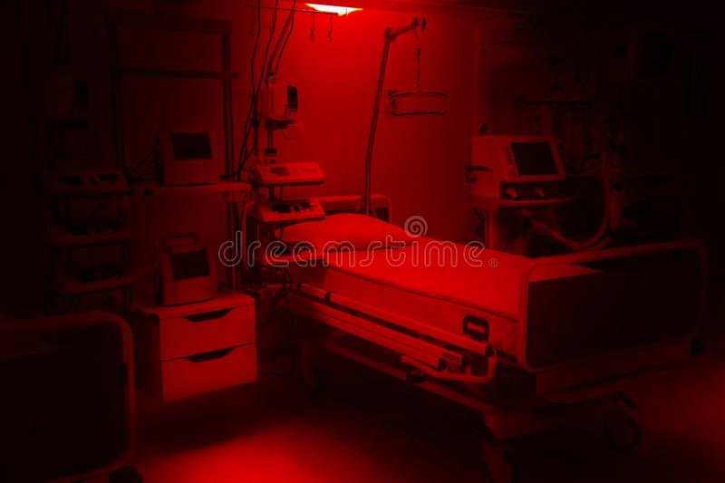 Dark dramatic red colors. fear and anxiety hospital emergency room intensive care. modern equipment, concept of healthy medicine, stock photos