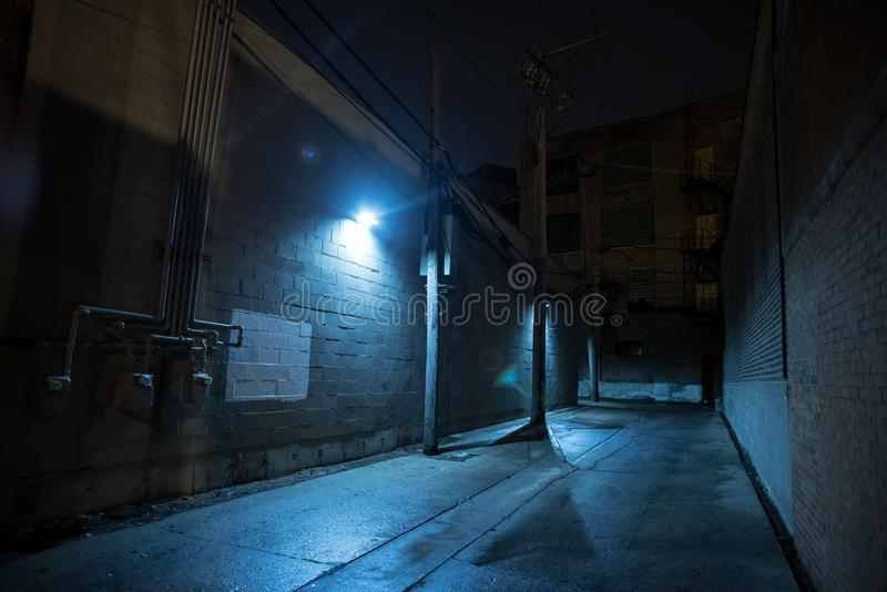 Dark and eerie urban city alley at night. Dark and eerie Chicago urban city alley at night royalty free stock photo