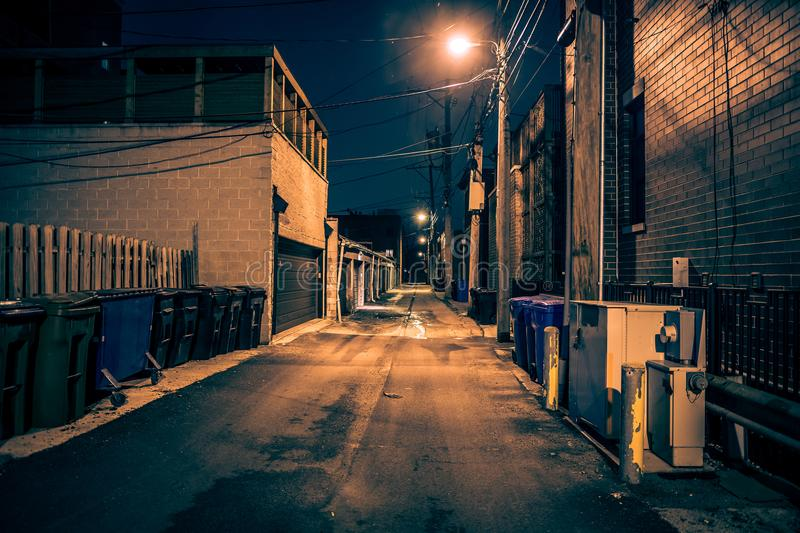 Dark urban city alley at night. Dark and eerie urban city alley at night stock photos
