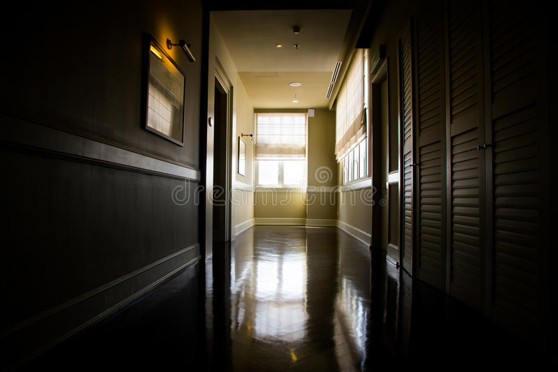 Dark and empty corridor with available natural light from window. Dark, empty, mysterious corridor with available natural light from window stock photos