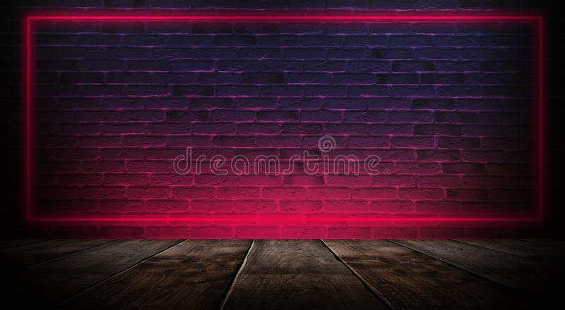 Dark empty room with brick walls and neon lights, smoke, rays. Brick wall, concrete and wooden table stock image