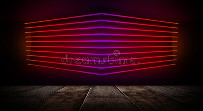 Dark empty room with brick walls and neon lights, smoke, rays. Brick wall, concrete and wooden table royalty free stock image