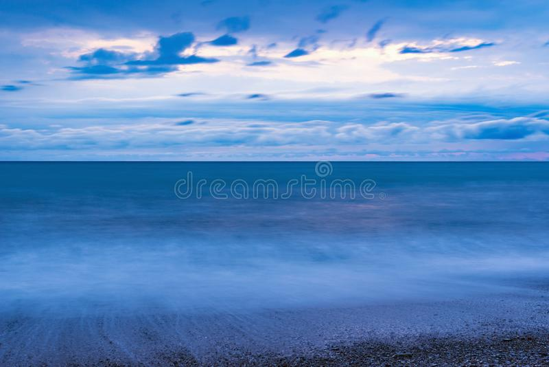 Dark evening sky above the sea. royalty free stock photos