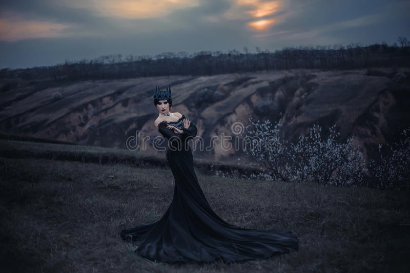 Dark evil queen. Sneaks through the stone canyon, Lady of fire, wild Princess, vampire, thigh toning, creative color, dark-Boho royalty free stock photography