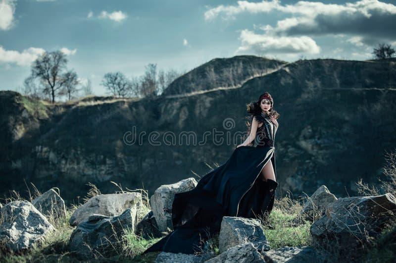 Dark evil queen. Sneaks through the stone canyon, wild Princess , vampire , hip toning , creative color,dark boho stock photos